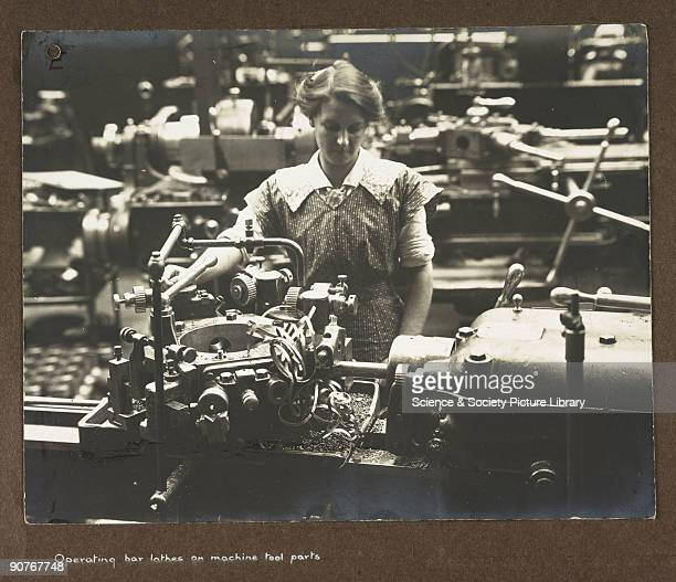 A photograph taken by an unknown photographer during 19151918 of a woman operating machinery in a British factory During World War One many British...