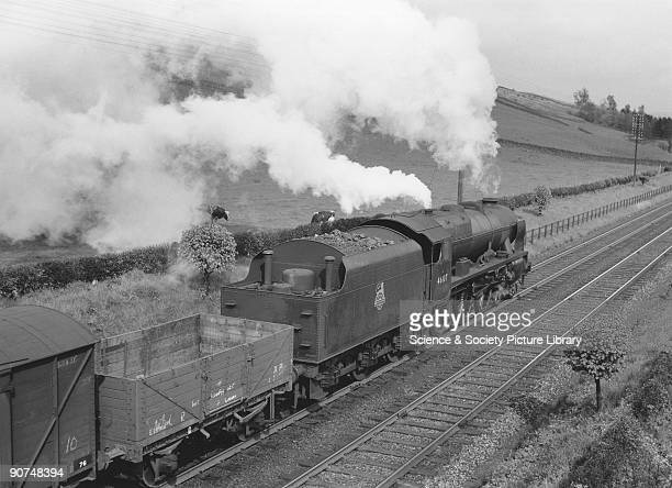 Photograph taken by Bishop Eric Treacy of the Argyll Sutherland Highlander with a goods train on the West Coast Main Line at Beattock Dumfries and...
