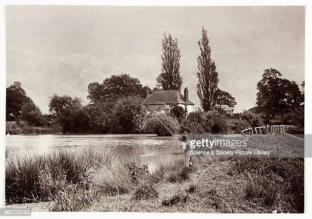 A photograph taken by Colonel Joseph Gale in 1893 A man fishes in a mill pond on a summer's day The fishing rod is a simple pole and line to which...