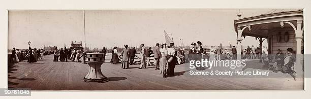Photograph taken by George Davison showing people dressed in their Sunday best enjoying a stroll along the pier The photograph was taken with a No 4...