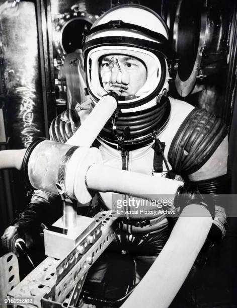 Photograph taken during the testing of a space suit The engineer at the Republic Aviation Corporation's research laboratory New York pedals away on a...