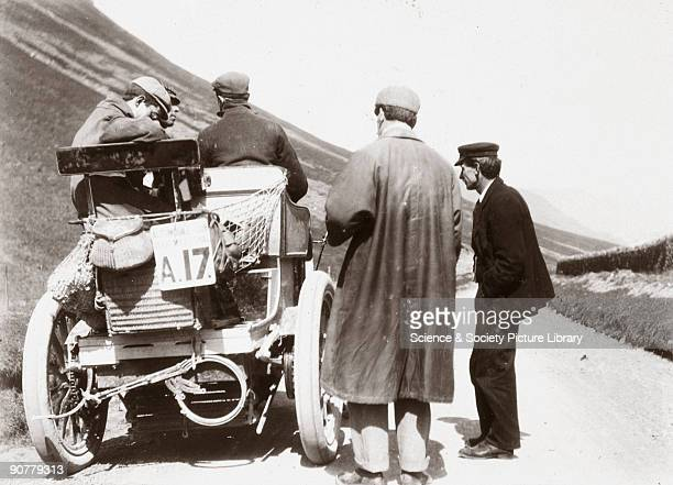 Photograph taken from an album of prints collected by English motorist, motor car manufacturer and aviator Charles Stewart Rolls , showing men around...