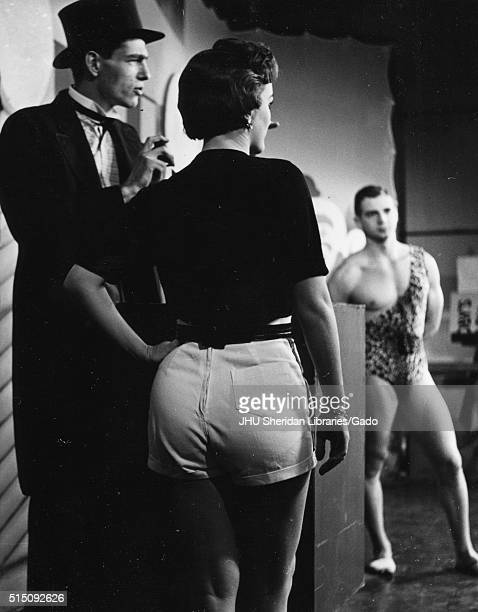Photograph taken from behind the scenes of the television show The Johns Hopkins Science Review depicting actors Lynn Rosenthal Dick Manson and...