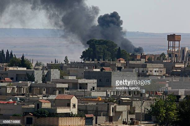 Photograph taken from Sanliurfa's Suruc district Turkey shows smoke rises from Syria's Ayn alArab city following the shelling during clashes between...