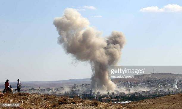 A photograph taken from Suruc district of Sanliurfa southeastern province of Turkey shows smoke rises following airstrikes carried out by the USled...
