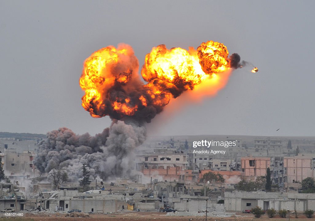 A photograph taken from Suruc district of Sanliurfa, Turkey, near Turkish-Syrian border crossing shows smoke rising from the Syrian border town of Kobani (Ayn al-Arab) following the US-led coalition airstrikes against the Islamic State of Iraq and the Levant (ISIL) targets on October 30, 2014.