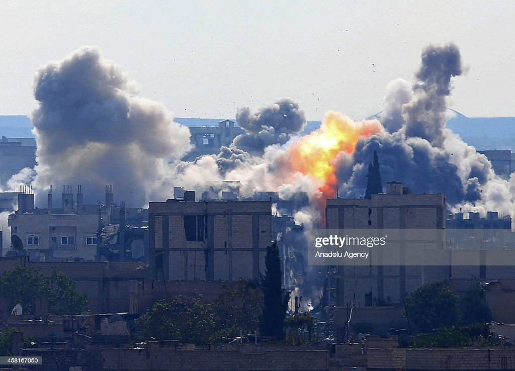A photograph taken from Suruc district of Sanliurfa, Turkey, near Turkish-Syrian border crossing shows smoke rising from the Syrian border town of Kobani (Ayn al-Arab) following the US-led coalition airstrikes against the Islamic State of Iraq and the Levant (ISIL) targets on October 31, 2014.