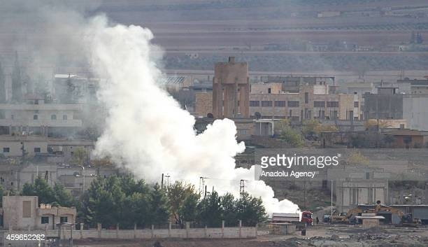 Photograph taken from Suruc district of Sanliurfa, Turkey, near Turkish-Syrian border crossing shows smoke rising from the Syrian border town of...