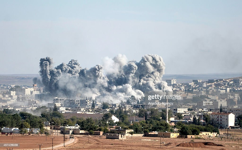 A photograph taken from Suruc district of Sanliurfa, Turkey, shows smoke rising from the Syrian border town of Kobani (Ayn al-Arab) following the US-led coalition airstrikes against the Islamic State of Iraq and the Levant (ISIL) on October 18, 2014.