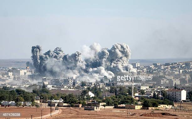 Photograph taken from Suruc district of Sanliurfa, Turkey, shows smoke rising from the Syrian border town of Kobani following the US-led coalition...