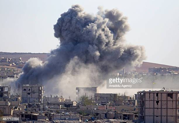 A photograph taken from Suruc district of Sanliurfa Turkey shows smoke rising from the Syrian border town of Kobani following the USled coalition...