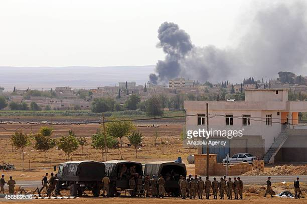 Photograph taken from Suruc district of Sanliurfa Turkey shows that smoke rises following the shelling as the clashes near to the TurkishSyrian...