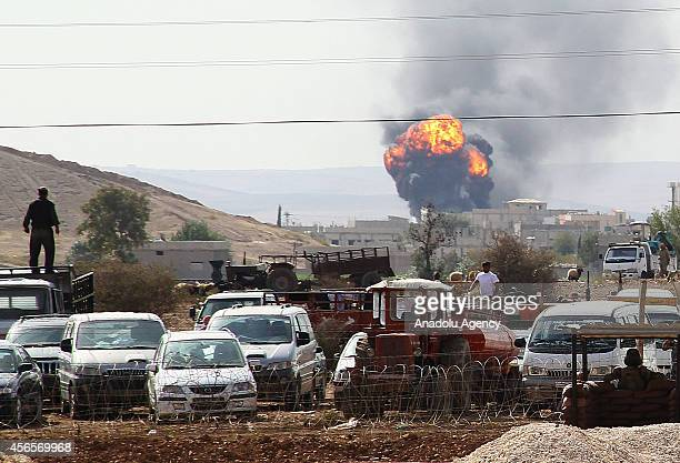 Photograph taken from Suruc district of Sanliurfa, Turkey shows that smoke rises following the shelling as the clashes near to the Turkish-Syrian...