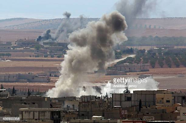 A photograph taken from the border line in Suruc district of Sanliurfa southeastern province of Turkey shows destroyed buildings and rising smoke as...