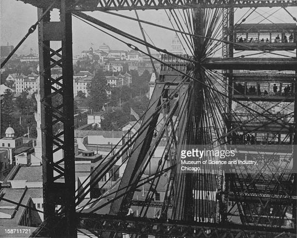 A photograph taken from the Ferris Wheel in midair of the large axle and surrounding grounds at the World's Columbian Exposition in Chicago Illinois...
