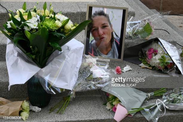 Photograph taken in Le Plan-de-la-Tour, southeastern France, shows bunches of flowers and the portrait of Doriane, a young woman who was murdered,...