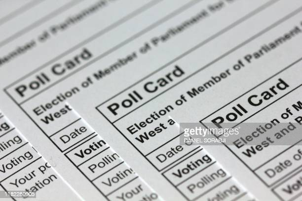 Photograph taken in London on November 14, 2019 shows polling cards for the 2019 UK general election arranged as an illustration.