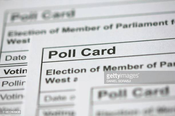 A photograph taken in London on November 14 2019 shows polling cards for the 2019 UK general election arranged as an illustration
