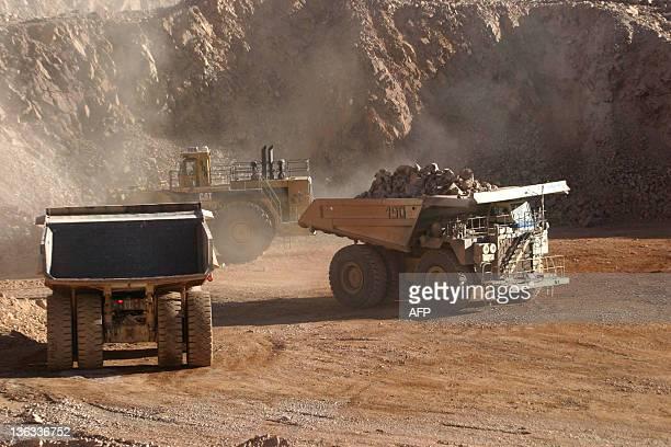 Photograph taken in March 2006 showing trucks at work in the copper mine La Escondida in the Antofagasta region 1800 km north of Santiago Chilean...