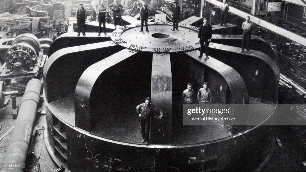 Photograph taken of a giant electric generator. Dated 20th century.