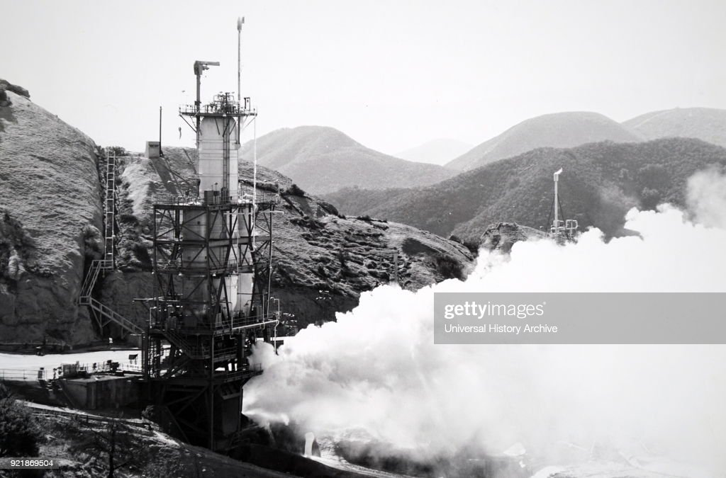 Photograph taken of the Rocketdyne J-2 test firing. The J-2 was a liquid-fuel cryogenic rocket engine used of NASA's Saturn IB and Saturn V launch vehicles. Dated 20th century.
