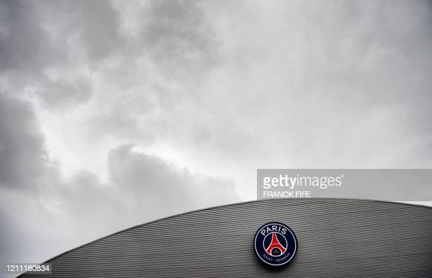 Photograph taken on April 28, 2020 shows the Paris-Saint-Germain logo on the roof of the Parc des Princes stadium in Paris on the 43rd day of a...