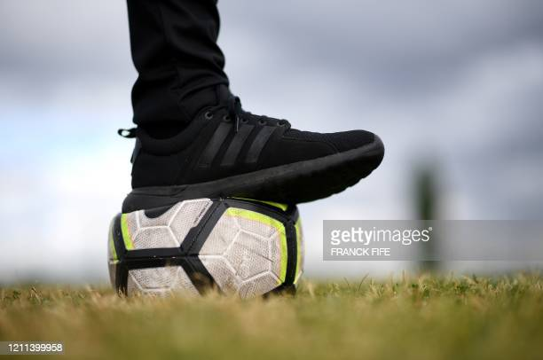 """Photograph taken on April 30, 2020 shows a football ball on the field of the amateur football club """"FC Parisis"""" at the club training centre, in..."""