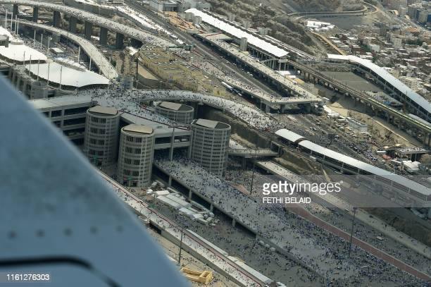 Photograph taken on August 12, 2019 shows an aerial view of Muslim worshippers arriving in Mina to throw pebbles as part of the symbolic al-A'qabah...
