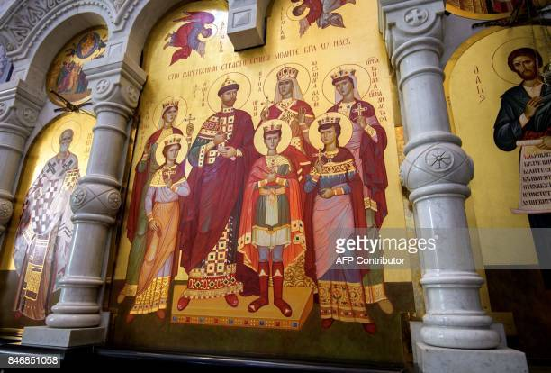 A photograph taken on August 19 2017 shows an Orthodox icon of the last Russian tsar Nicholas II family in the Savior on Blood Cathedral in...