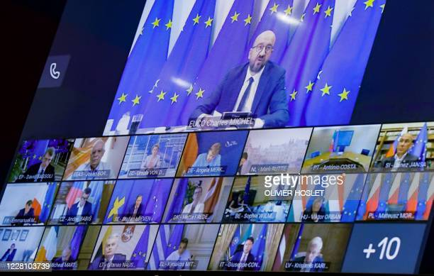 Photograph taken on August 19, 2020 at the EU headquarters in Brussels shows a screen displaying European Council President Charles Michel, European...