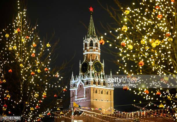 A photograph taken on December 11 2018 shows Kremlin's Spasskaya Tower with Christmas and New Year decorations on the Red Square in Moscow