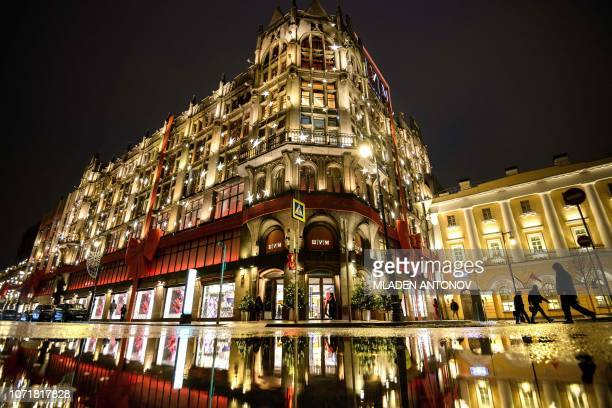 A photograph taken on December 11 2018 shows the TsUM department store building illuminated for Christmas and New Year in Moscow
