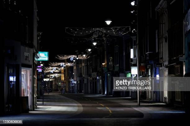 Photograph taken on January 26, 2021 shows deserted streets of Den Bosch during the curfew time, a day after police clashed with groups of...