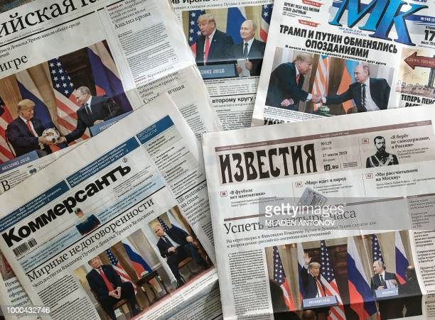 A photograph taken on July 17 2018 in Moscow shows the front pages of Russia's main newspapers featuring pictures of the summit between US President...