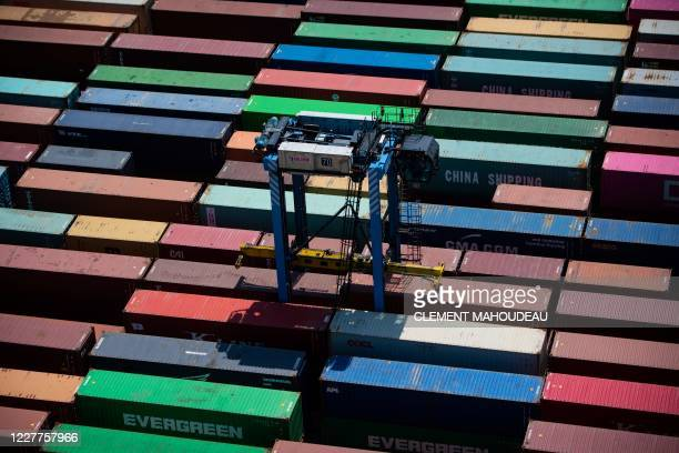 A photograph taken on July 23 2020 from an industrial gantry crane shows containers on the docks of the EuroFos terminal at the FosSurMer harbour in...