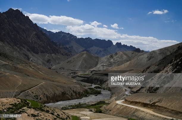 Photograph taken on June 21, 2020 shows a view of the highway through Karakoram mountans connecting Kashmir valley with Ladakh. - India and China...