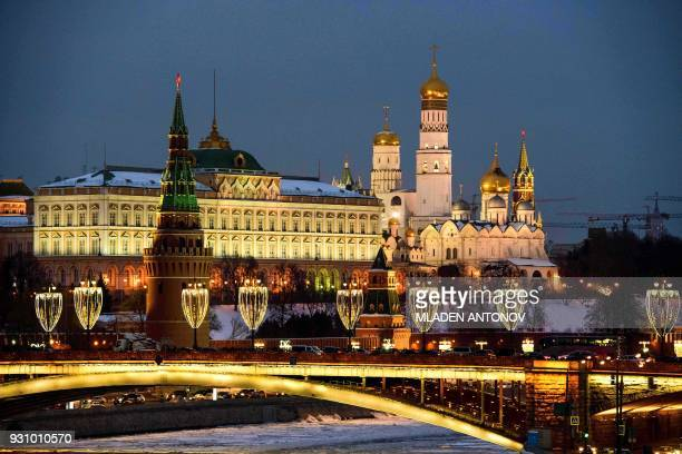 A photograph taken on March 12 2018 shows the Kremlin complex and the Bolshoy Kamenny bridge crossing the river Moskva in Moscow Russia warned the...