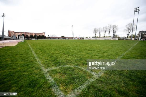Photograph taken on March 14, 2020 shows an empty football stadium in Saint Denis, near Paris. - This weekend's Six Nations international between...