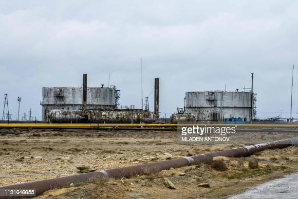 A photograph taken on March 19 2019 shows a part of Surakhani Oil Field situated at the coast of the Caspian Sea outside Baku after being...