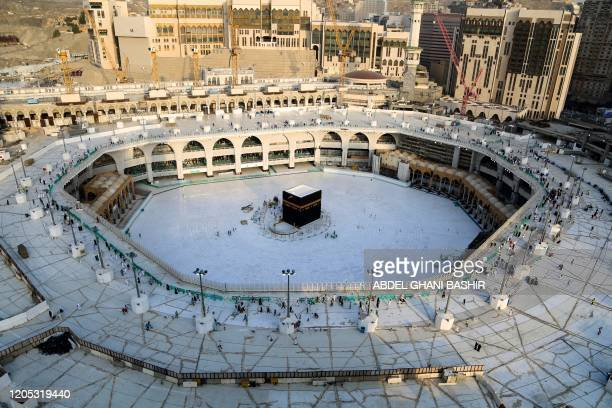 TOPSHOT A photograph taken on March 5 2020 shows the whitetiled area surrounding the Kaaba inside Mecca's Grand Mosque empty of worshippers Saudi...
