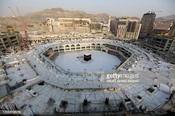 A photograph taken on March 5 2020 shows the whitetiled area surrounding the Kaaba inside Mecca's Grand Mosque empty of worshippers Saudi Arabia...