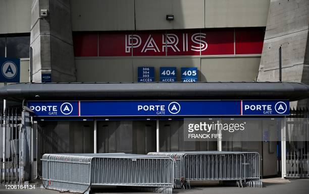 A photograph taken on March 9 2020 shows a view of a gate of the Parc des Princes stadium in Paris two days ahed of the UEFA Champions League Group A...
