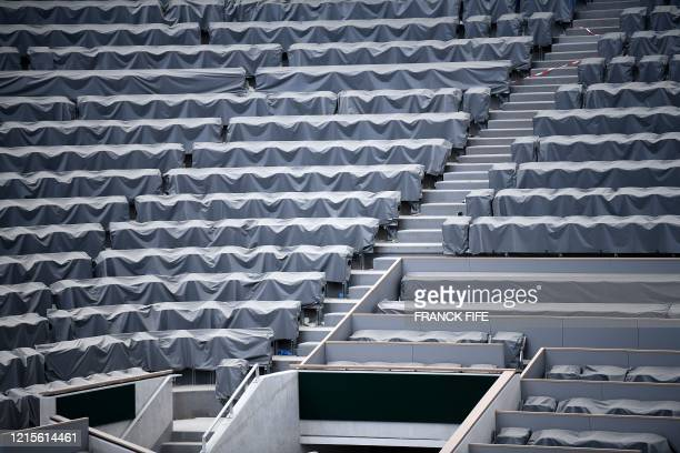 A photograph taken on May 27 2020 shows the empty rows of seats at the Philippe Chatrier central tennis court at the Roland Garros stadium in Paris...