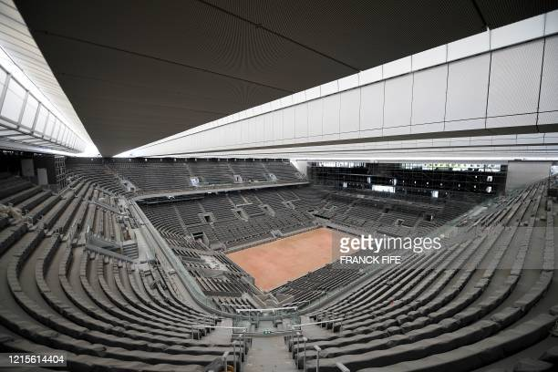 Photograph taken on May 27, 2020 shows the newly built roof and the Philippe Chatrier central tennis court at the Roland Garros stadium, in Paris. -...
