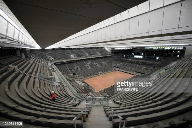 A photograph taken on May 27 2020 shows the newly built roof and the Philippe Chatrier central tennis court at the Roland Garros stadium in Paris The...