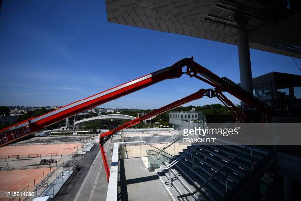 A photograph taken on May 27 2020 shows the outside of the Philippe Chatrier central tennis court with its newly built roof at the Roland Garros...