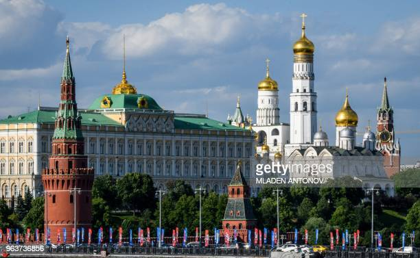 A photograph taken on May 30 2018 shows a bridge decorated with FIFA World Cup 2018 flags in front of the Kremlin in Moscow The FIFA World Cup 2018...