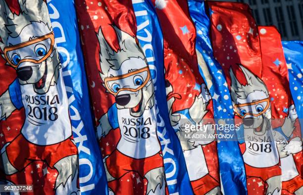 A photograph taken on May 30 2018 shows FIFA World Cup 2018 flags featuring the tournament mascot 'Zabivaka' in Moscow The FIFA World Cup 2018...