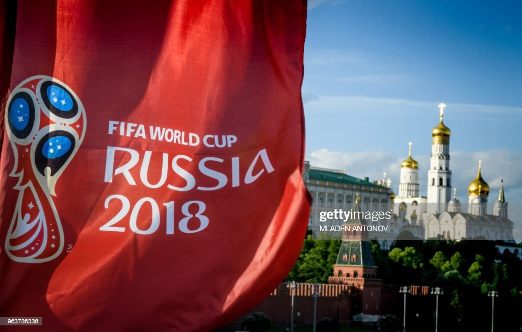 A photograph taken on May 30, 2018 shows the FIFA World Cup 2018 flag in front of the Kremlin in Moscow. - The FIFA World Cup 2018 tournament kicks off on June 14, 2018.