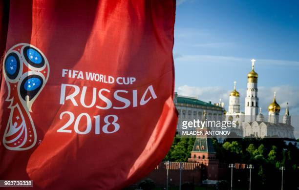 A photograph taken on May 30 2018 shows the FIFA World Cup 2018 flag in front of the Kremlin in Moscow The FIFA World Cup 2018 tournament kicks off...